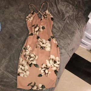 A flowery dress , WORE ONE TIME,